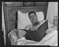 Billy Stamps reads in bed, Pasadena, 1935