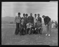 Johnny Weissmuller demonstrates his golf swing in front of a group of unidentified S.M.U. football players, Pasadena, 1935