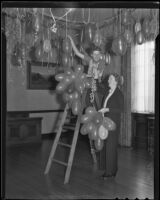 Anna Butts and Norma Crowell in charge of decorations at the Ebell Club for New Year's Eve, Los Angeles, 1935