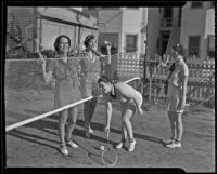 Janice Blanchfield, Eleanor Lawrence, Rosemarie Fredericks, and Margaret Hillebrecht play badminton, 1935