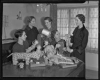 Mrs. Martin Askey, Elizabeth Scattergood, Marjorie Martin, Mrs. J. Thomas Mahl, and Lucile Criley Moon with toys and stuffed animals they will be donating to needy children, 1935