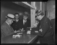 Murder suspect Samuel Whittaker being booked at Central Jail, Los Angeles, 1936