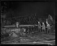 Firefighters put out junkyard fire, Los Angeles, 1936