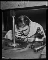 Raymond Laborda closely examines a precious gem, Los Angeles, 1936