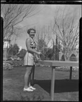 Phyllis Jeffrey plays table tennis on her vacation, Palm Springs, 1936