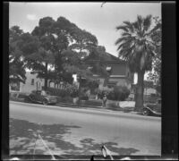 Wilson West stands in front of the West's former home, Los Angeles, 1936