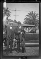 H. H. West and Abraham Whitaker stand beside a car at West't house, Los Angeles, about 1929
