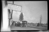 Tom's Place grocery store with 2 cars and 3 people in front, Toms Place, 1929
