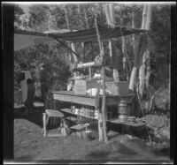 Mertie West and Edith Shaw next to a temporary camping kitchen at Convict Lake, Mammoth Lakes vicinity, 1929