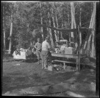 Mertie West, Edith Shaw, and Agnes Whitaker next to a temporary camping kitchen at Convict Lake, Mammoth Lakes vicinity, 1929