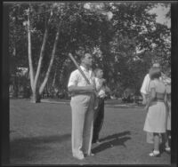 Everett Shaw holds a baseball bat in Victory Park, Los Angeles, 1931