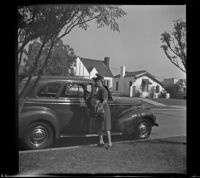 Mertie West getting out of a car in front of the house of William H. Shaw, Los Angeles, 1942