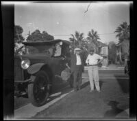 H. H. West and William Shaw stand next to West's car while H. H. West Jr. leans out the window before departure for Twin Lakes, Los Angeles, 1929