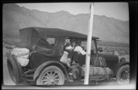 H. H. West Jr. and William Shaw sit in H. H. West's car en route to Twin Lakes from Los Angeles, 1929
