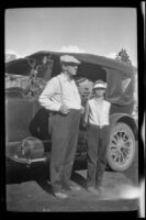 H. H. West Jr. and William Shaw stand next to H. H. West's car en route to Twin Lakes from Los Angeles, 1929