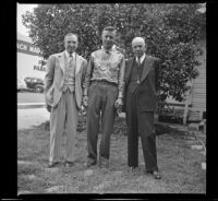 Wayne West, Lynn West, and H. H. West stand in front of an orange tree in Wayne West's yard, Santa Ana, 1942