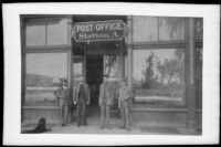 Charles Robb, F. S. Putnam, Winn J. Sanborn and Charles Hawthorne stand in front of Downey Avenue Station A Postoffice, Los Angeles, about 1889 or 1890