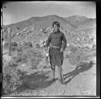Wilfrid Cline holding the first rabbit that he had even killed at Ash Creek, Owens valley vicinity, about 1916