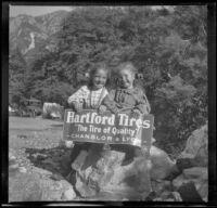 Elizabeth and Frances West hold a sign for Hartford Tires, Mount Baldy, 1914
