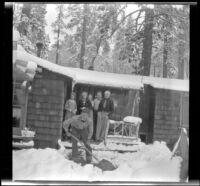 Neil Wells, Mertie West, Agnes Whitaker, Frances Wells, H. H. West, Jr. and Forrest Whitaker standing on the front porch of the Neil Wells cabin, Big Bear, 1932