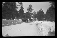 H. H. West's Buick and another car travel along a snowy road, Big Bear, 1932