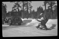 Mertie West and Neil Wells prepare for a sled ride behind H. H. West's Buick, Big Bear, 1932
