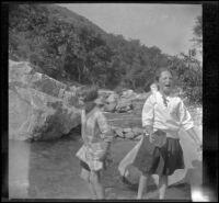 Frances Cline and Frances West play in Big Tujunga Creek, Sunland-Tujunga vicinity, 1912