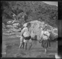 Elizabeth West, Frances West and Frances Cline wade in Big Tujunga Creek, Sunland-Tujunga vicinity, 1912