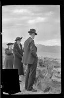 Zetta Witherby, Mertie West and Wes Witherby stand and look out onto the Lake Mead reservoir, Boulder City vicinity, 1939
