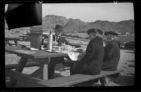 Wes Witherby, Mertie West and Zetta Witherby eat lunch on the shore of Lake Mead, Boulder City vicinity, 1939