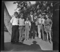 A group of boys, including H. H. West, Jr., pose for a photograph after taking tests for the Boy Scouts, Los Angeles, 1931