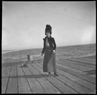 Pinkie (Ellen Lorene) Lemberger stands on the pier, Santa Monica, about 1900 or 1901