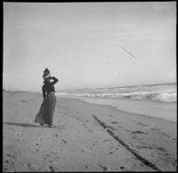 Pinkie (Ellen Lorene) Lemberger stands down on the sand and looks out at the ocean, Santa Monica, about 1900 or 1901