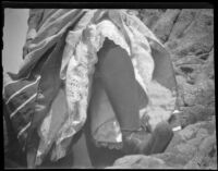 Woman from the waist down, with her foot resting on a rock, Santa Catalina Island, 1903