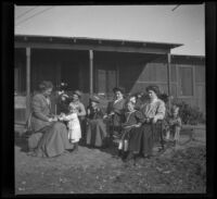 The Nelsons, Salbachs and Wests pose for a photograph on Thanksgiving Day, Orange County vicinity, 1912
