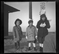 Edward Salbach, Frances West and Elizabeth West pose for a photograph on Thanksgiving Day, Huntington Beach, 1912