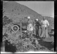 Bessie McGee Velzy, Elizabeth West and Minnie West stand around the camp near Convict Lake, Mammoth Lakes vicinity, 1914