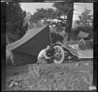 Glen Velzy works on H. H. West's Buick, Mammoth Lakes vicinity, 1915