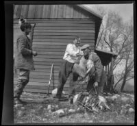 Dave F. Smith puts ducks on Waller Chanslor as Fred Gilmer watches, Gorman vicinity, circa 1910s