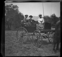 Nella West, Charlie Rucher and Louise Ambrose sit in carriage en route to Devils Gate, Pasadena, 1899