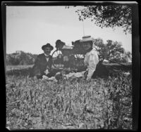 Charlie Rucher, Nella West and Louise Ambrose dine in the grass at Devils Gate, Pasadena, 1899