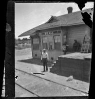 Cuthbert Kellum stands at the Pima train station, Pima, 1895