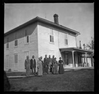 Members of the Lemberger family pose outside a house, Germanville, 1900