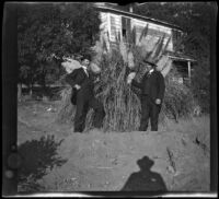 Will Mead and a man named Davis pose by a Pampas grass plant on the grounds, Glendale, 1898