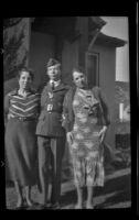 Elizabeth West Siemsen, H. H. West, Jr. and Frances West Wells pose for a photograph outside Elizabeth's house, Glendale, 1939