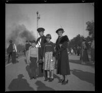 Richard Siemsen, H. H. West, Jr., Dottie Siemsen and Mertie West wait for a train, Glendale, 1937