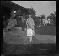 Frances West poses with a tennis racket, Glendale, 1921
