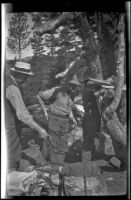 Charlie Stavnow and Glen Velzy breaking up camp on the trip to Gardner Creek, about 1919