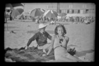 Mertie West and Margaret Deming pose on the beach, Hermosa Beach, 1937