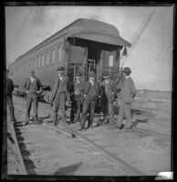 Southern Pacific Railroad employees pose in front of a train car, Salton Sea vicinity, about 1899